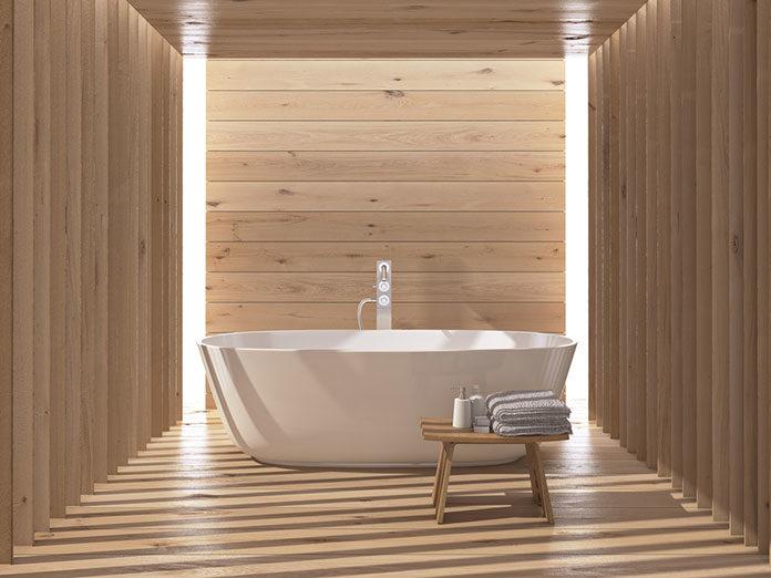 Szukasz pomysłu na modną łazienkę? Co powiesz na wykończenie w drewnie?